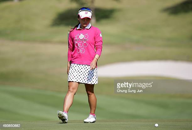 Chie Arimura of Japan looks over a green on the 1st hole during the second round of the Nobuta Group Masters GC Ladies at the Masters Gold Club on...