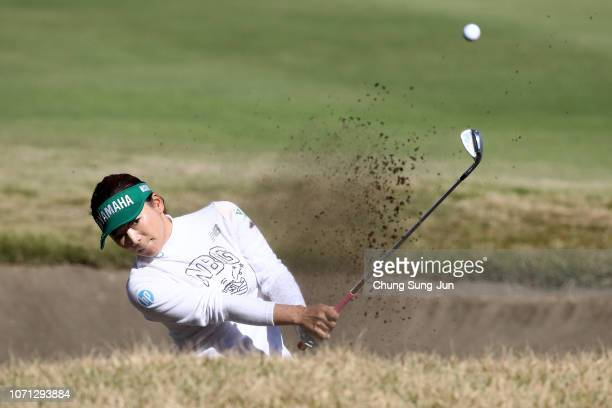 Chie Arimura of Japan plays a bunker shot on the 15th hole during the second round of the LPGA Tour Championship Ricoh Cup at Miyazaki Country Club...