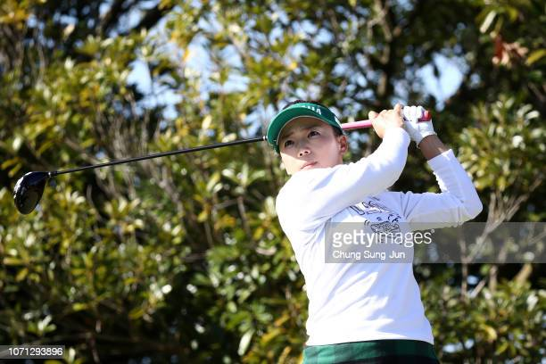 Chie Arimura of Japan plays a tee shot on the 3rd hole during the second round of the LPGA Tour Championship Ricoh Cup at Miyazaki Country Club on...