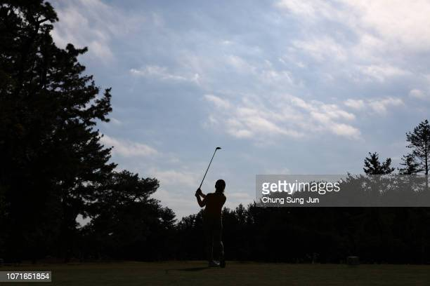 Chie Arimura of Japan plays a tee shot on the 8th hole during the third round of the LPGA Tour Championship Ricoh Cup at Miyazaki Country Club on...
