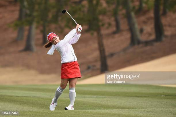 Chie Arimura of Japan plays her second shot on the 1st hole during the final round of the TPoint Ladies Golf Tournament at the Ibaraki Kokusai Golf...