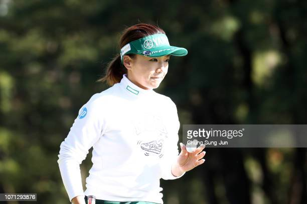 Chie Arimura of Japan reacts after a putt on the 18th hole during the second round of the LPGA Tour Championship Ricoh Cup at Miyazaki Country Club...