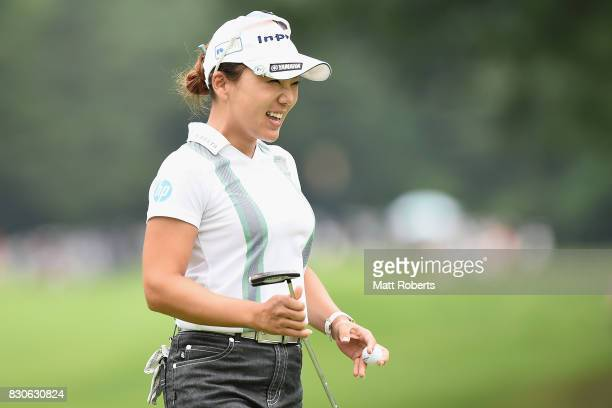 Chie Arimura of Japan reacts after her putt on the 18th green during the second round of the NEC Karuizawa 72 Golf Tournament 2017 at the Karuizawa...