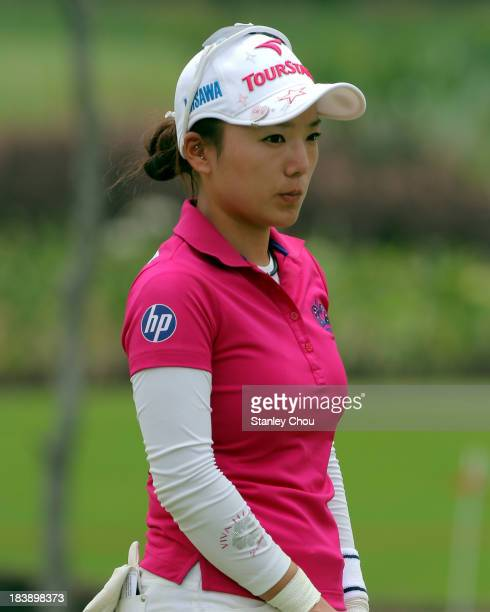 Chie Arimura of Japan waits for her turn to play on the 12th hole during day one of the Sime Darby LPGA Malaysia at Kuala Lumpur Golf Country Club on...