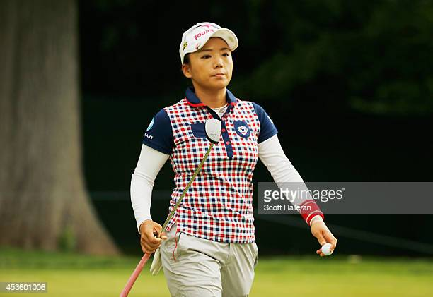 Chie Arimura of Japan walks off the 11th green during the first round of the Wegmans LPGA Championship at Monroe Golf Club on August 14 2014 in...