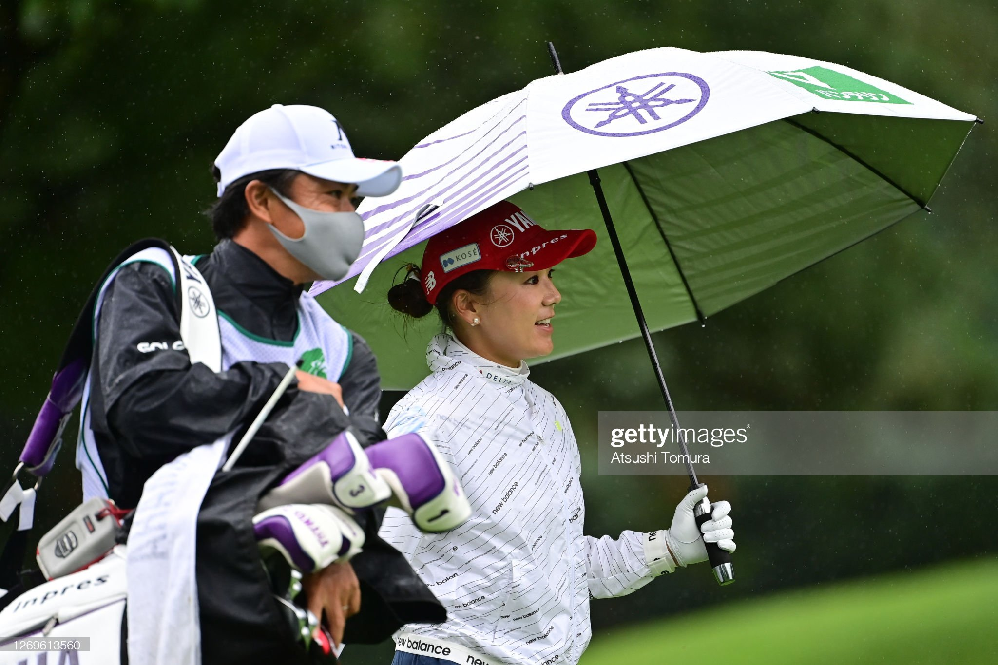 https://media.gettyimages.com/photos/chie-arimura-of-japan-walks-with-her-caddie-on-the-6th-hole-during-picture-id1269613560?s=2048x2048