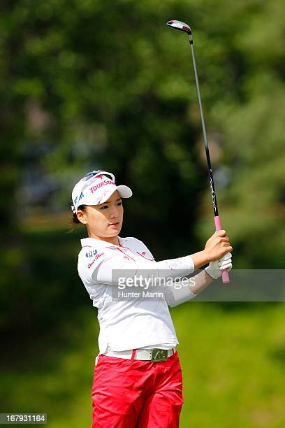 Chie Arimura of Japan watches her second shot on the 18th hole during the first round of the Kingsmill Championship at Kingsmill Resort on May 2 2013...