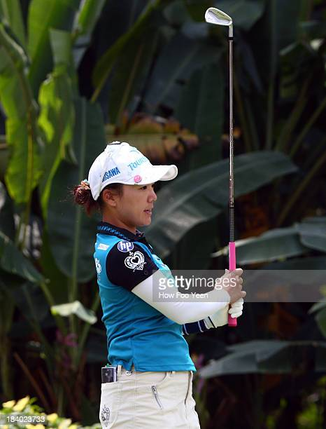 Chie Arimura of Japan watches her tee shot on the 17th hole during day two of the Sime Darby LPGA Malaysia at Kuala Lumpur Golf Country Club on...