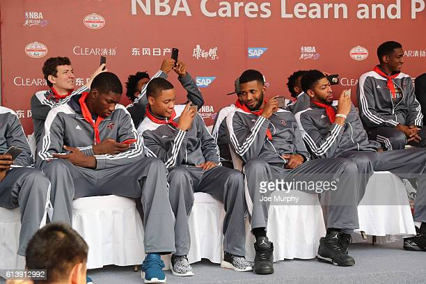 Chieck Diallo Tim Frazier Alonzo Gee and Anthony Davisof the New Orleans Pelicans takes in the NBA Cares Learn and Play Center Dedication part of the...