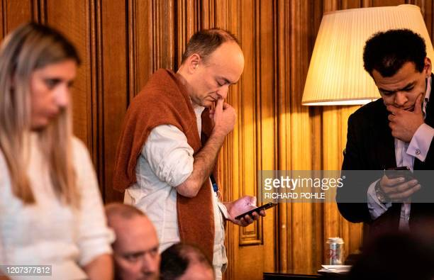 Chief advisor to the Prime Minister Dominic Cummings listens to Boris Johnson as he gives a press conference on the ongoing COVID-19 situation with...