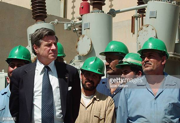 Chief American Coalition Provisional Authority Administrator J. Paul Bremer inaugurates a recently refurbished generator at the Najaf power plant...