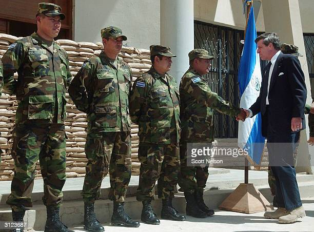 Chief American Coalition Provisional Authority Administrator J Paul Bremer congratulates an El Salvadoran military unit March 23 2004 in Najaf Iraq...