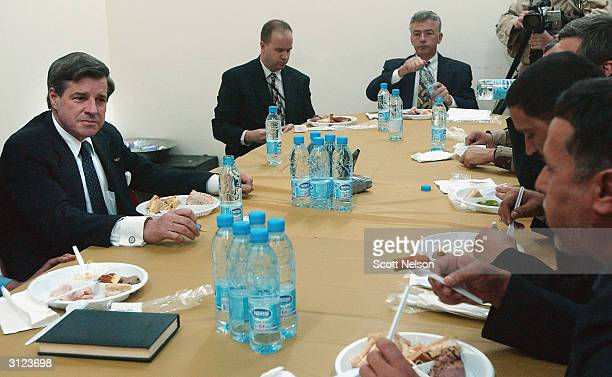 Chief American Coalition Provisional Authority Administrator J. Paul Bremer conducts a working lunch meeting with local Iraqi leaders March 23, 2004...