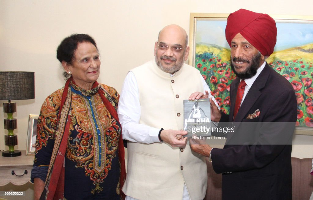 Chief Amit Shah with Milkha Singh and his wife Nirmal Kaur during a meeting at his residence Sector 8 on June 7 2018 in Chandigarh India