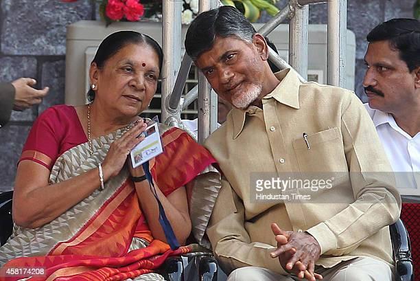 TDP chief and Chief Minister of Andhra Pradesh Chandra Babu Naidu with Gujarat Anandiben Mafatbhai Patel during the swearingin ceremony of BJP leader...