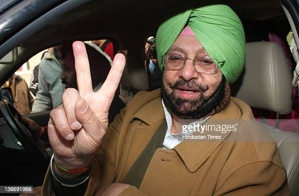 Chief and former CM of Punjab Capt Amarinder Singh showing victory sign after filing the nomination form as a Congress candidate from Patiala seat on...