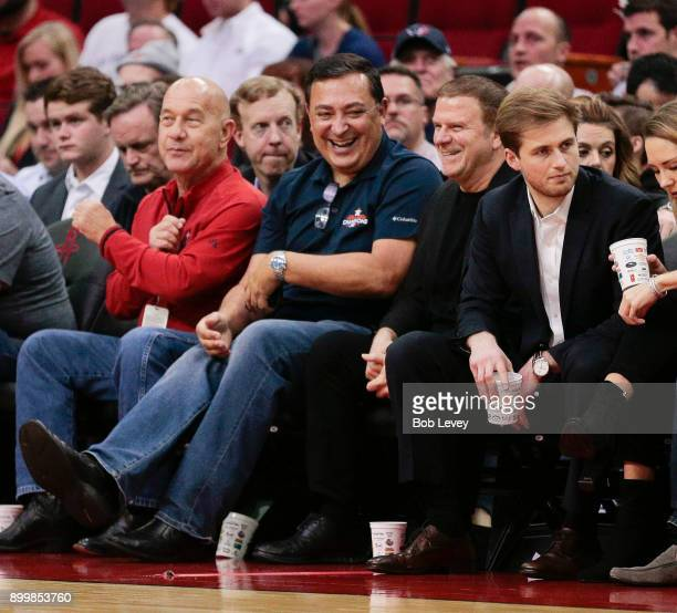 Chief Art Acevedo of the Houston Police Department shares a laugh with Houston Rockets owner Tilman Fertitta at Toyota Center on December 20, 2017 in...