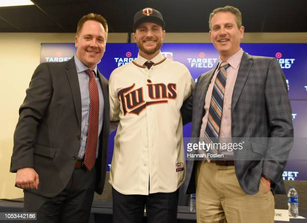 Chief Baseball Officer Derek Falvey Manager Rocco Baldelli and General Manager Thad Levine of the Minnesota Twins pose for a photo as Baldelli is...