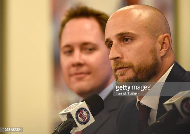 Chief Baseball Officer Derek Falvey of the Minnesota Twins looks on as new manager Rocco Baldelli speaks as Baldelli is introduced at a press...