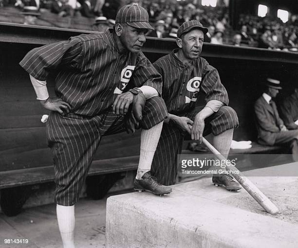 Chief Bender left and Eddie Collins both coaches for the Chicago White Sox pose in the dugout before a game at Yankee Stadium in New York in 1925