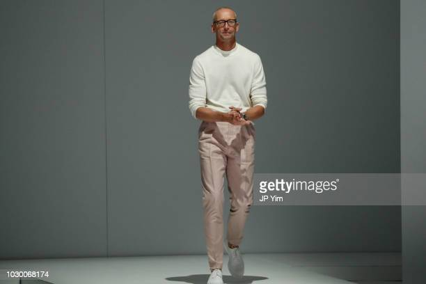 Chief Brand Officer Hugo Boss Ingo Wilts walks the runway at the BOSS Womenswear Menswear Spring/Summer 2019 Collection at Pier 36 on September 9...