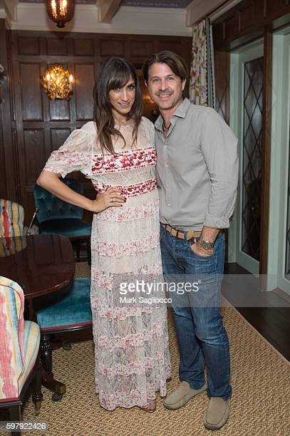 Chief Brand Officer Mandana Dayani and Roger Berman attend the Ashley And Jeff McDermott host an intimate Hamptons party for EBTH on August 28 2016...