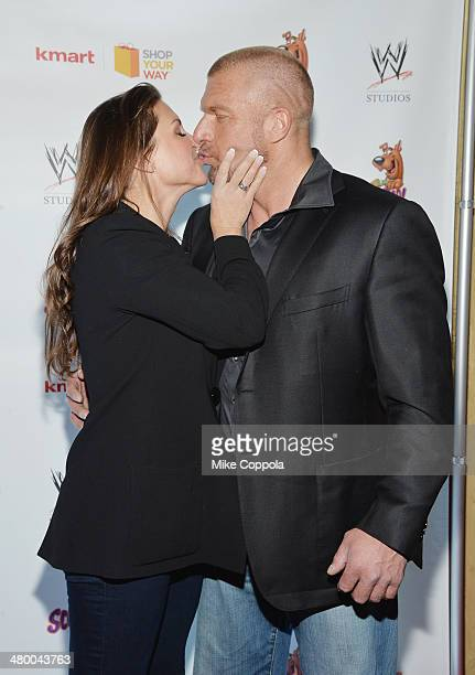 Chief Brand Officer Stephanie McMahon and husband/WWE Wrestler Triple H kiss during the 'Scooby Doo WrestleMania Mystery' New York Premiere at...