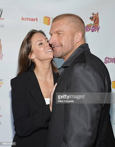 Chief Brand Officer Stephanie McMahon and husband/WWE Wrestler Triple H attend the 'Scooby Doo WrestleMania Mystery' New York Premiere at Tribeca...