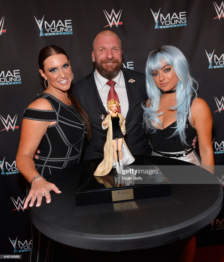 WWE Chief Brand Officer Stephanie McMahon, WWE Executive Vice President of Talent, Live Events and Creative Paul 'Triple H' Levesque and actress/YouTube personality Inanna Sarkis appear on the red carpet of the WWE Mae Young Classic on September 12, 2017 in Las Vegas, Nevada.