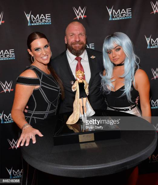 WWE Chief Brand Officer Stephanie McMahon WWE Executive Vice President of Talent Live Events and Creative Paul Triple H Levesque and actress/YouTube...