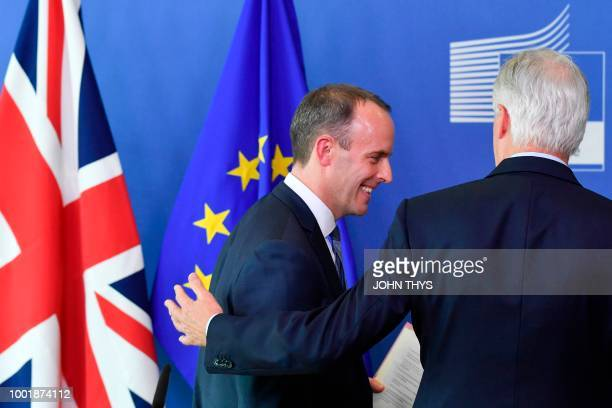 EU Chief Brexit Negotiator Michel Barnier and Britain's Secretary of State for Exiting the European Union Dominic Raab leave after their joint press...