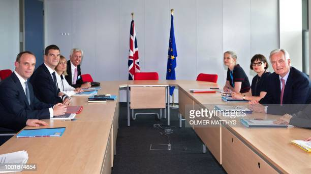 EU Chief Brexit Negotiator Michel Barnier and Britain's Secretary of State for Exiting the European Union Dominic Raab attend a meeting at the...