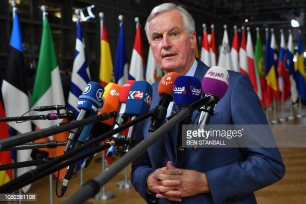 EU Chief Brexit negotiator Michel Barnier answers to journalists upon her arrival at the European Council in Brussels on October 17 2018 British...