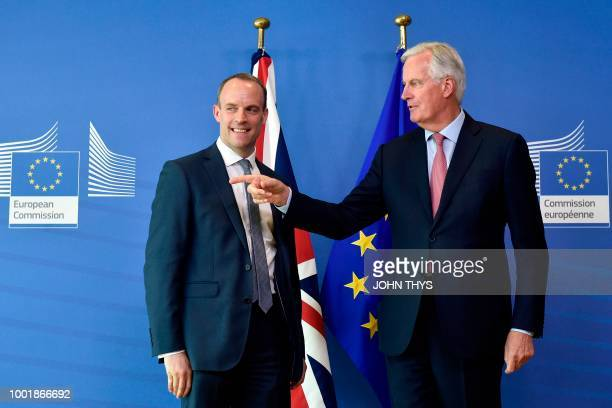 EU Chief Brexit Negotiator Michel Barnier gestures next to Britain's Secretary of State for Exiting the European Union Dominic Raab during their...