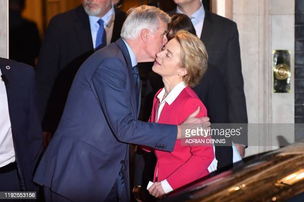 EU chief Brexit negotiator Michel Barnier kisses European Commission President Ursula von der Leyen as they leave from 10 Downing Street in central...