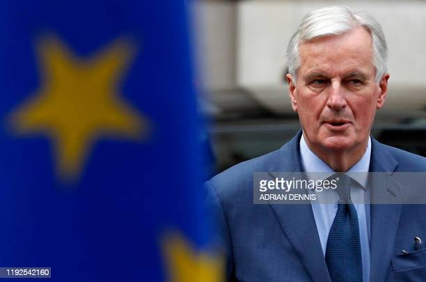 EU chief Brexit negotiator Michel Barnier passes an EU flag as he leaves the London School of Economics in London on January 8 after listening to a...