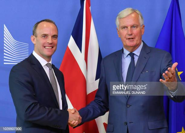 EU Chief Brexit Negotiator Michel Barnier shakes hands with Britain's Brexit Secretary Dominic Raab during their meeting at the European Commission...