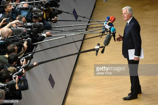 EU chief Brexit negotiator Michel Barnier speaks to the press as he arrives at a special meeting of the European Council to endorse the draft Brexit...