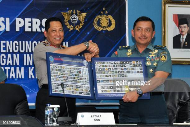 BNN chief Budi Waseso poses for a photo with Navy Security S Irawan during a press conference after confiscating 1375 tons of methamphetamine at the...