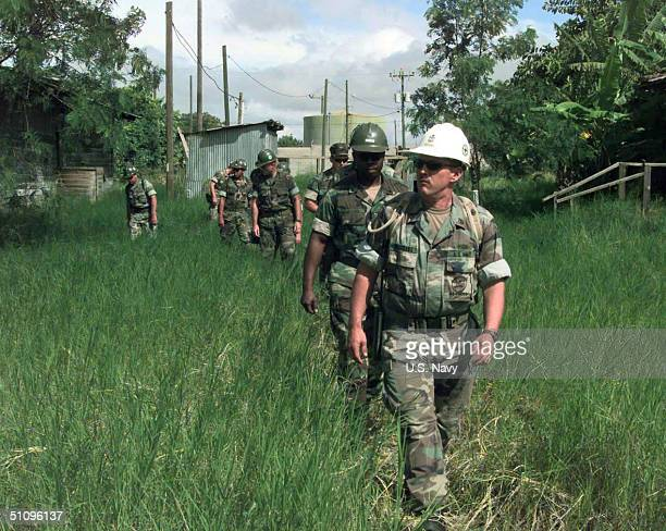 Chief Builder Curtis Riechart Assigned To Naval Mobile Construction Battalion Seven Leads A Team Of Seabees To The Demolition Site Nmcb7 Is Currently...