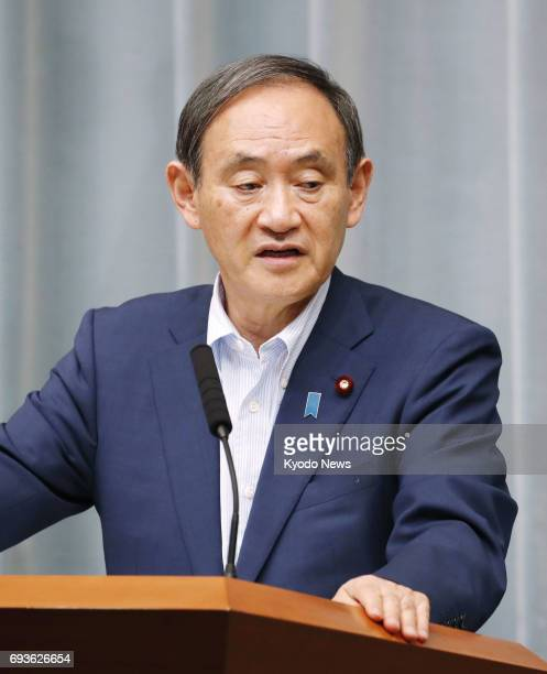 Chief Cabinet Secretary Yoshihide Suga attends a press conference in Tokyo on June 8 after North Korea testfired what are believed to be...