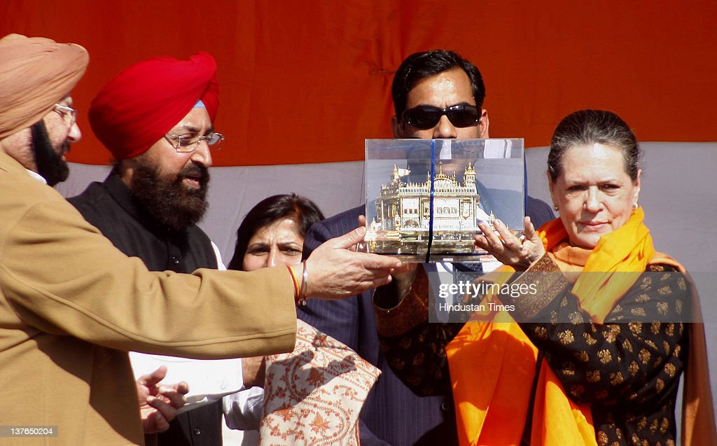 Chief Capt, Amarinder Singh along with MP Partap Singh Bajwa presents a memento of a Golden Temple to Congress Party President, Sonia Gandhi during an election rally on January 24, 2012 in Gurdaspur, India. Addressing the rally, Congress Party President lashed out at incumbent SAD-BJP government in Punjab for not utilizing central funds for development of state and pushing Punjab into backwardness.