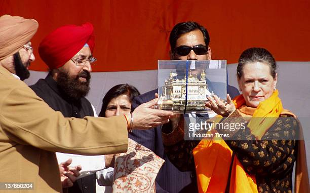 PPCC Chief Capt Amarinder Singh along with MP Partap Singh Bajwa presents a memento of a Golden Temple to Congress Party President Sonia Gandhi...