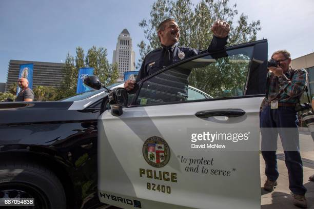 Chief Charlie Beck stands at one of two new Ford Fusion hybrid pursuitrated Police Responder cars unveiled at Los Angeles Police Department...