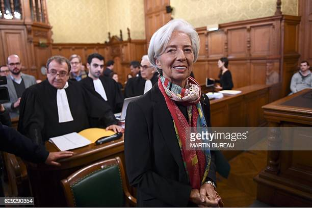 IMF chief Christine Lagarde and her lawyer Patrick Maisonneuve wait in a courtroom of the Paris courthouse on December 12 2016 prior to the start of...