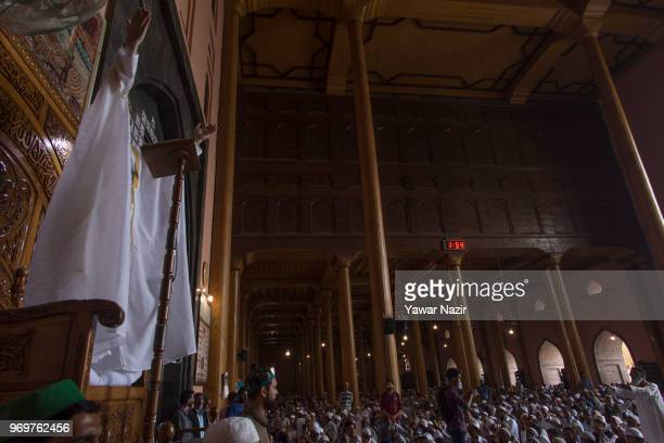 Chief cleric Mirwaiz Umar Farooq delivers sermon in Kashmir's Grand Mosque on the last Friday of the holy Islamic month of Ramadan on June 8, 2018 in...