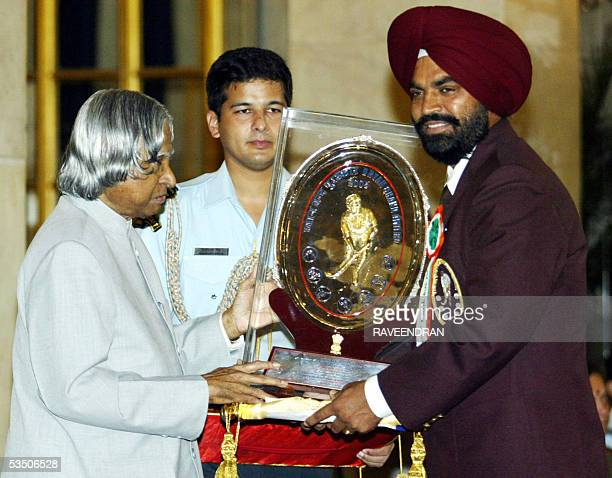 Chief coach of India's men's hockey team Rajinder Singh receives the prestigious Dhyan Chand Award from Indian President APJ Abdul Kalam at a sports...