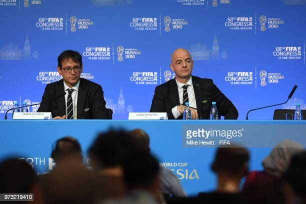 FIFA Chief Communications Officer Fabrice Jouhaud and FIFA President Gianni Infantino speak during the 68th FIFA Congress at Moscow's Expocentre on...