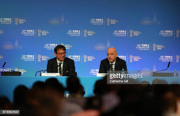 Chief Communications Officer Fabrice Jouhaud and FIFA President Gianni Infantino speak during the 68th FIFA Congress press conference on June 13 2018...