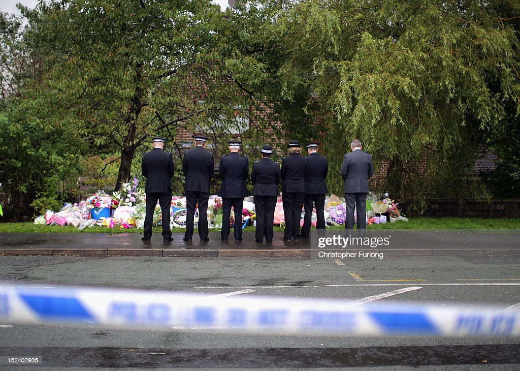 Chief Constable of Greater Manchester Police Sir Peter Fahy (3rd from left) and other senior officers pause for thought after laying flowers near to the scene of the shooting of WPC's Nicola Hughes and Fiona Bone in Hattersley on September 20, 2012 in Manchester, England. Local man Dale Cregan, 29, has been arrested in connection with the shooting of WPC's Nicola Hughes and Fiona Bone, who suffered fatal injuries in a gun and grenade attack in Mottram, during a routine call to investigate a burglary in Abbey Gardens on Tuesday.